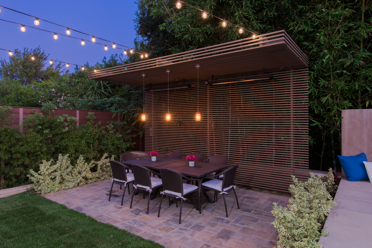 Steel trellis over outdoor dining area on Sunset Boulevard