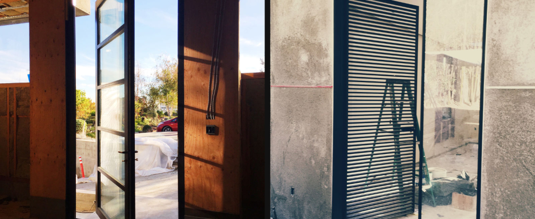 5-Los-Angeles-CA-Doheny-Residence-Front-Door-Chis-Bath-Door-1600x1056-1100x450.jpg