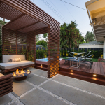 Metal slat outdoor shade structure around seating area