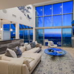 Ocean sunset, comfortable furniture, open floor plan, kitchen island.