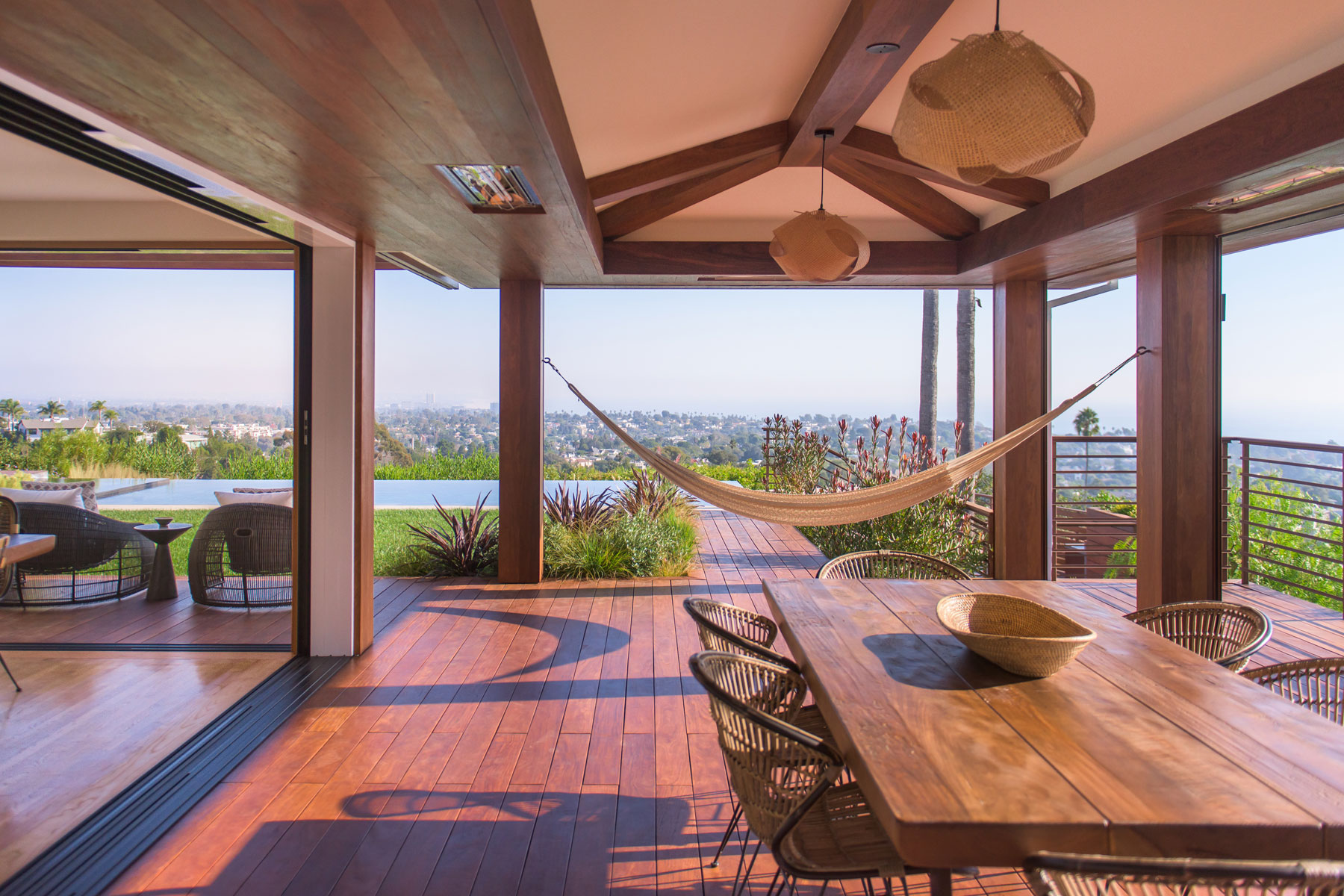 Dining room open to outdoor dining with disappearing doors