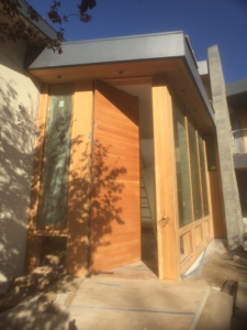 Pivoting front door with Douglas Fir