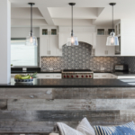 Kitchen island serves as space delimitator in large, open concept floor plan