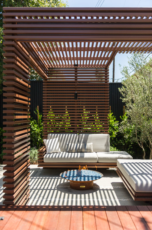 Firepit seating area with wood alternative steel trellis