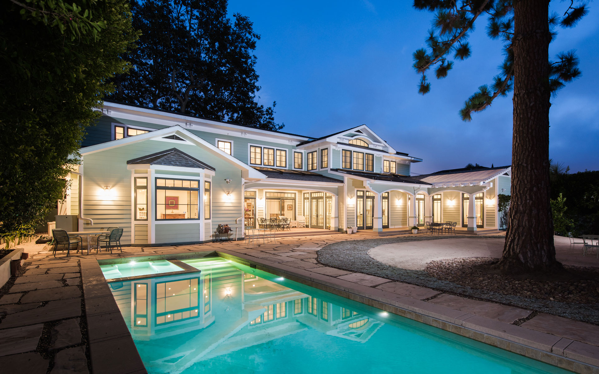 Rear yard with view of pool and porches and dining pation