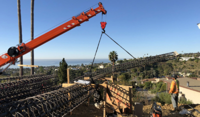 Cranes and Heavy Equipment need for hillside contruction in Los Canoas