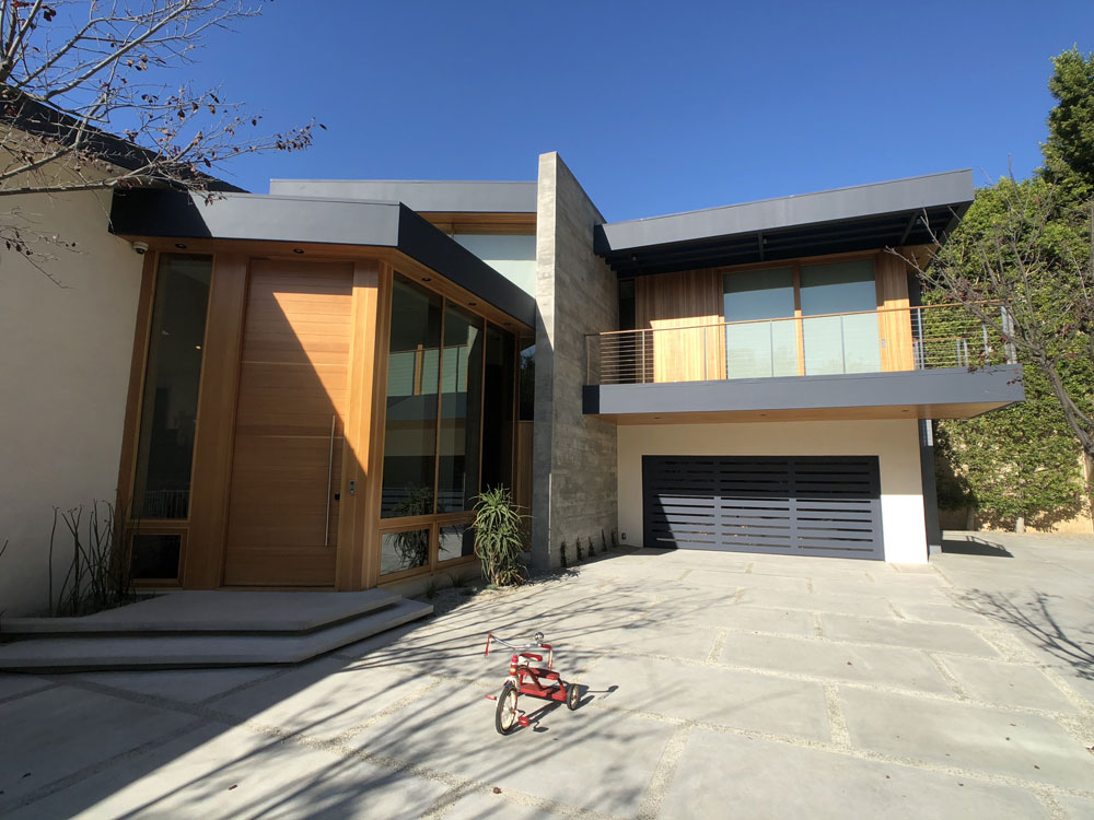 Minizing the prominence of the garage door in the design of a contemporary home
